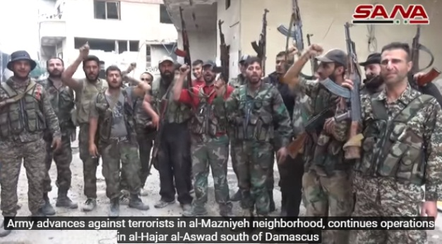 Syrian army soldiers celebrating in the Al-Madhaniya neighborhood after its takeover.