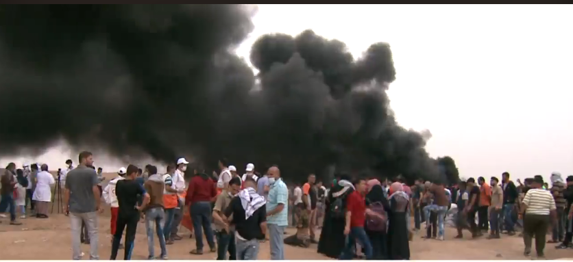 "Burning tires during the ""Return March"" east of Jabalia (Al-Jazeera Net, May 4, 2018)"