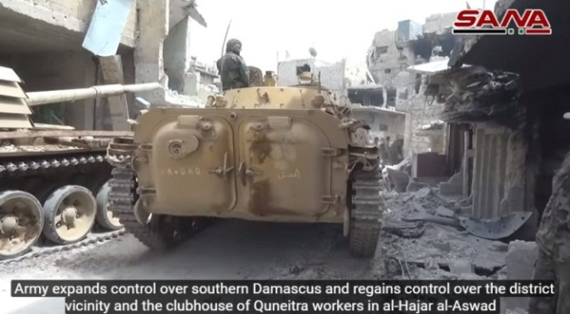 Syrian army armored force in the Al-Hajar al-Aswad neighborhood.
