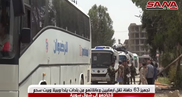 Some of the buses which evacuated operatives of the Headquarters for the Liberation of Al-Sham and their families in the third phase (SANA, May 5, 2018)