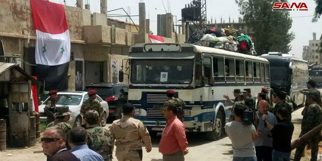 Two of the buses that evacuated the operatives of the Headquarters for the Liberation of Al-Sham and their families in the first phase (SANA, May 4, 2018).