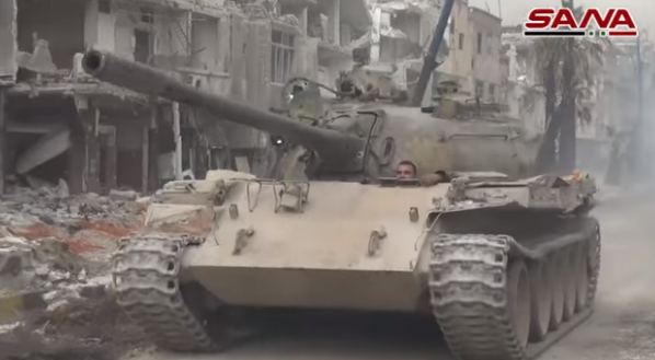 Syrian army tank in the Al-Hajar al-Aswad neighborhood (SANA, May 10, 2018)