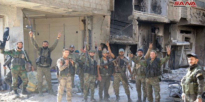 Syrian army soldiers in the Al-Hajar al-Aswad neighborhood (SANA, May 12, 2018).