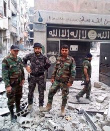 Syrian soldiers in the Yarmouk refugee camp near a school previously used by Ashbal al-Khilafah, ISIS's youth movement which turns ISIS's children into operatives of the organization (FortRussNews@ Twitter account, May 19, 2018)