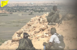 Kurdish forces observing the village of Hajin (SDF Facebook page, May 20, 2018)
