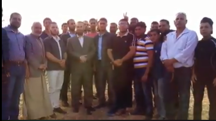 "Father and son (right) with senior Hamas figure Fathi Hamad, apparently at one of the recent ""return marches"" (Shehab Facebook page, May 16, 2018)"