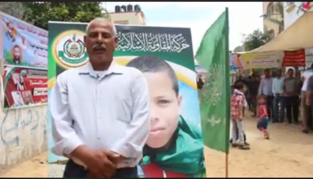 In the video Saadi Abu Salah's father says his son always talked about his desire to become a shaheed. Behind him is the death notice issued by Hamas.
