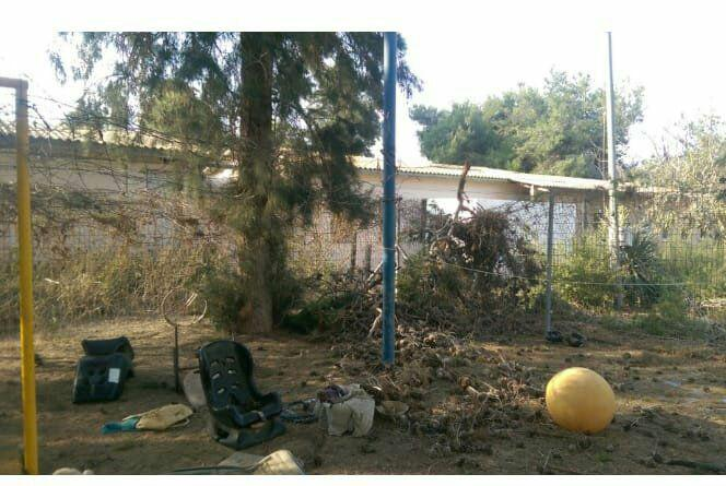 The yard of a kindergarten in one of the communities in the western Negev after the mortar shell hit