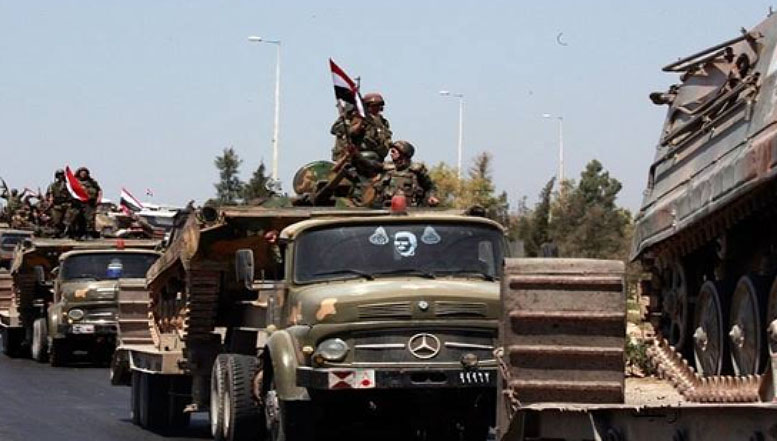 Column of Syrian army armored vehicles en route to Quneitra (Al-Hall, May 30, 2018).