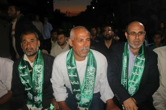 Sa'id Abu Salah (center), Saadi's father, wearing a green Hamas scarf, at the memorial service for his son organized by Hamas (Hamas media unit in Beit Hanoun, May 17, 2018).