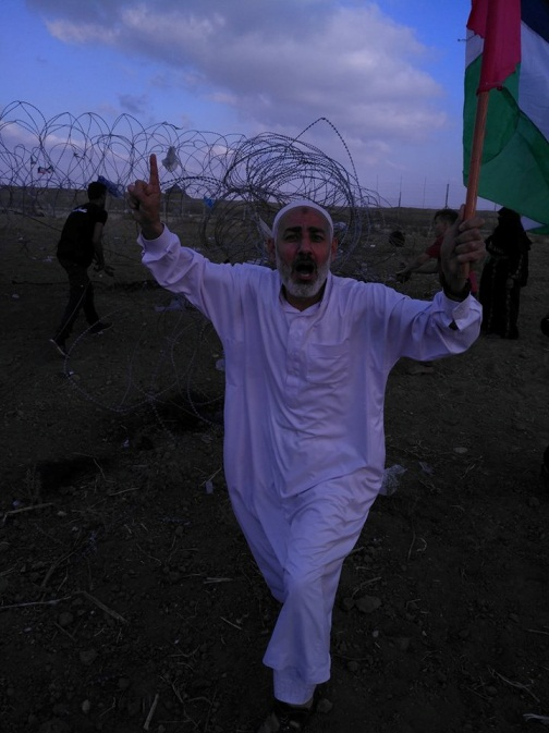"As'ad Abu Salah, Fahmi Abu Salah's father, demonstrating near the security fence in the northern Gaza Strip during the ""Great March of Return"" on Friday (June 1, 2018). His character inspired his sons to join terrorist organizations as operatives (Photo: As'ad Fahmi Abu Salah's Facebook page, June 2, 2018)"