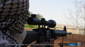 ISIS sniper observing Syrian army positions from the village of Al-Baghouz al-Fawqani.