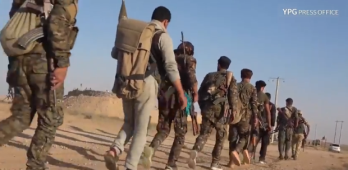 Column of SDF fighters on their way to operate against ISIS targets around Al-Dashisha (YPG Press Office, June 4, 2018)