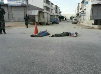 Bodies of two ISIS operatives lying in the street after being executed by the Headquarters for the Liberation of Al-Sham in the town of Al-Dana, north of Idlib (Haqq, June 1, 2018)