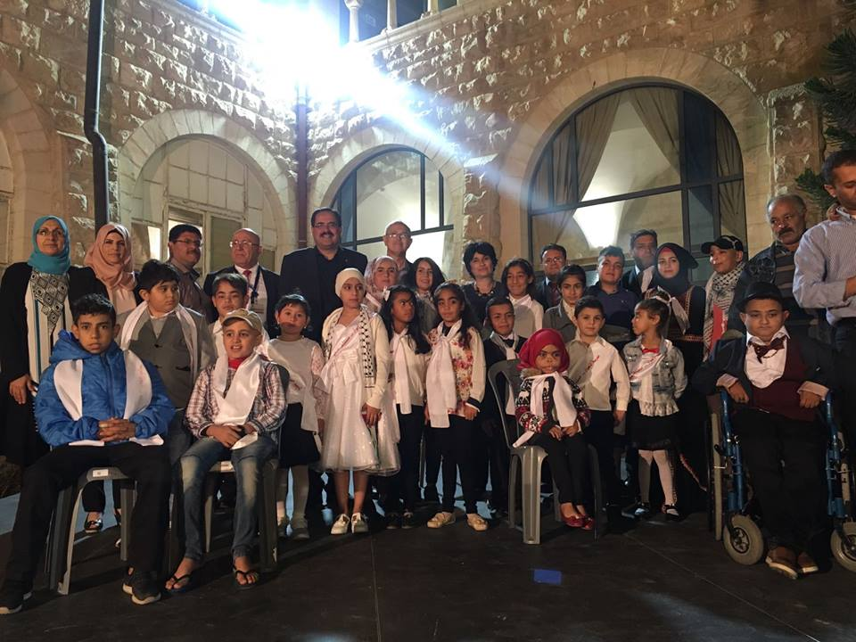 Sabri Saidam, PA minister of education, with students during a graduation ceremony (Facebook page of the Augusta Victoria hospital, June 4, 2018).