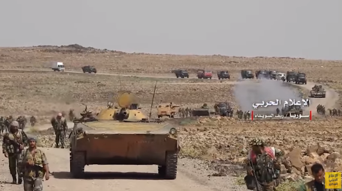 Column of armored vehicles of the Syrian army and forces supporting it moving to the ISIS enclave.
