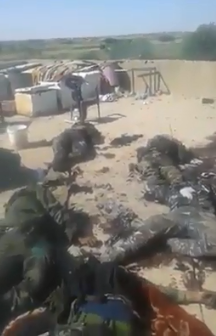 Bodies of Syrian soldiers and operatives of their supporting forces killed by ISIS in the area of Albukamal (Deir ez-Zor 24, June 10, 2018)