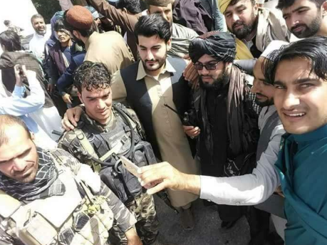 Taliban fighters and Afghan army soldiers celebrating the ceasefire in Afghanistan together (Haqq, June 16, 2018)