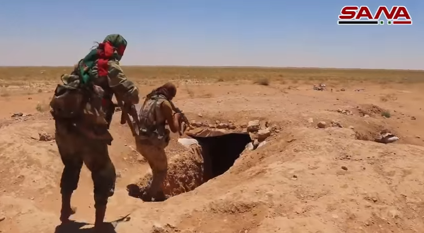 Fighters (apparently belonging to the Palestinian Al-Quds Brigade) searching a trench and a cave previously used by ISIS (SANA, June 20, 2018)