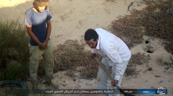 Suspected collaborator with the Egyptian army digging his own grave before being beheaded by ISIS operatives (Haqq, June 21, 2018)