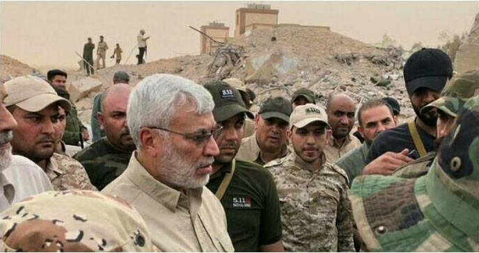Abu Mahdi al-Muhandis, deputy commander of the Popular Mobilization in Iraq, visiting the headquarters that was destroyed south of Albukamal (Zamanalwsl.net.news, June 29, 2018)