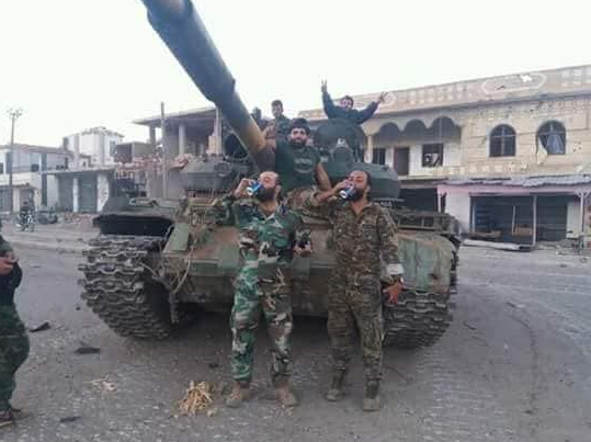 Fighters from the Syrian army and the Dhu al-Fiqar Brigade in a victory photo in Busra al-Harir.