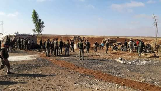 Syrian army soldiers and Dhu al-Fiqar Brigade fighters in the Buser region (Facebook page of the Dhu al-Fiqar Brigade June 26, 2018).
