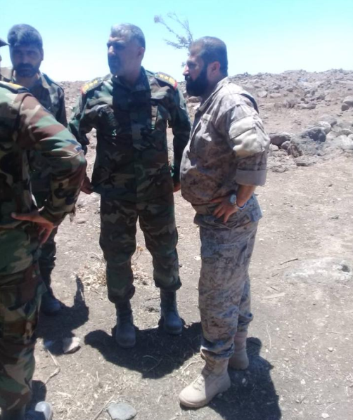 Abu Ajeeb (right) with Syrian army officers.