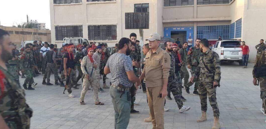 A picture that went viral on July 3, 2018, of Abu Ajeeb shaking hands with a man claimed to be a Russian army officer (right) (Twitter account of AbuSDam3@, 2018).