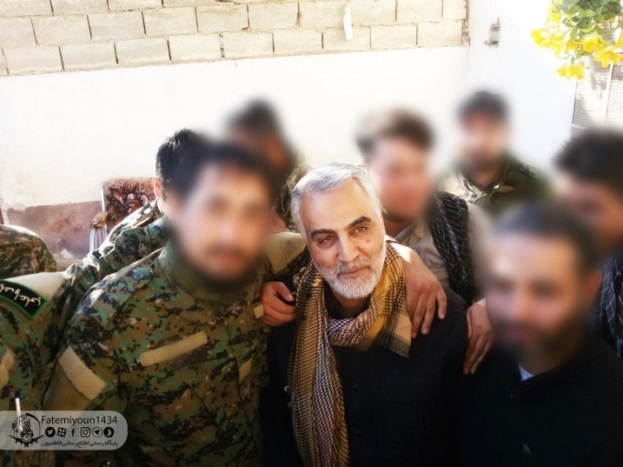 Qassem Soleimani, commander of the IRGC's Qods Force, during a visit to eastern Syria. He is shown with Fatemiyoun fighters who fought against ISIS and suffered heavy losses, (Fatemiyoun Brigade Telegram channel, June 10, 2018).
