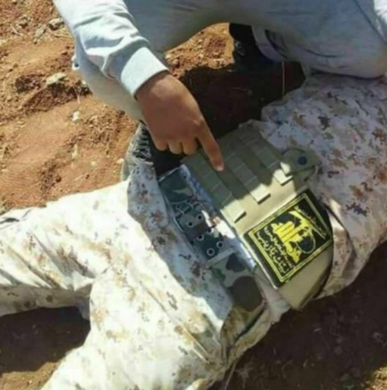 Hezbollah operative killed in the Lajah region. The hand is pointing at a Hezbollah emblem (Twitter account of HadiAlabdallah, June 22, 2018).