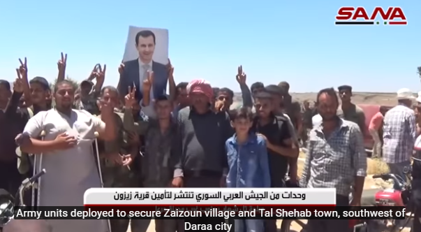 Residents of Tal Shihab cheering and waving photos of Syrian President Bashar Assad (SANA, July 9, 2018)