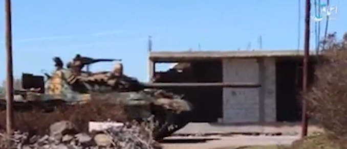 Tank of the Khaled bin Al-Walid Army during the military show of force of the organization in the Yarmouk Basin (Amaq, July 4, 2018)