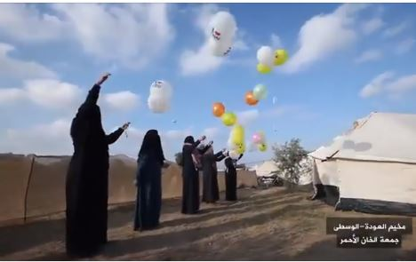 "‏‏Gazan women from the ""daughters of al-Zouari unit"" launch incendiary balloons at ""return march"" events on July 13, 2018 (Facebook page of the ""supreme national authority of the return march,"" July 13, 2018)."