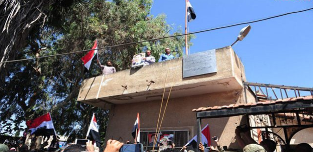 Syrian flags waved in the city of Tafas (SANA, 12 in July 2018).