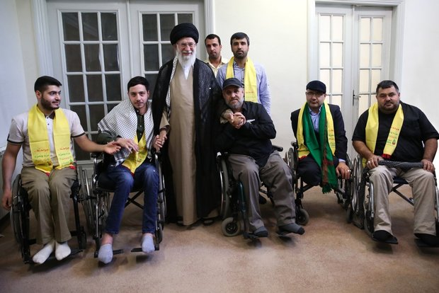 Iranian Supreme Leader with a delegation of Hezbollah fighters who were injured fighting in the 2006 Lebanon War (Mashregh News, July 13 2018).