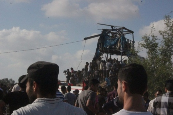 Palestinians gather around the observation post attacked by the IDF (Popular Front for the Liberation of Palestine information office Facebook page, July 21, 2018).