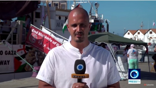 ‏‏Correspondent for the Iranian Press TV channel in English who joined the passengers aboard the Huriya (Press TV YouTube channel, July 22, 2018).