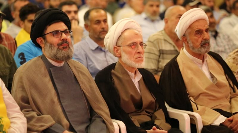 Sheikh Hashem Safi al-Din, head of Hezbollah's executive council (left), attends the July 21, 2018, ceremony in Nabatieh marking the anniversary of the Second Lebanon War (NNA agency, Lebanon, July 21, 2018).