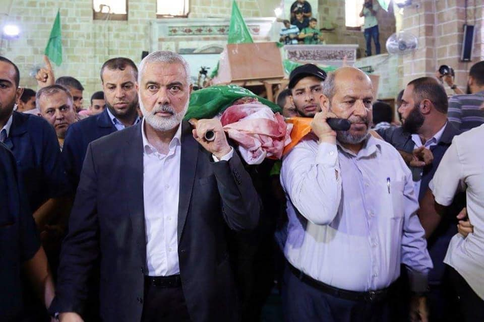 Isma'il Haniyeh, Khalil al-Haya and other senior Hamas figures at the funeral held for the three operatives of Hamas' military wing (Twitter account of Hamas' military wing, July 26, 2018).