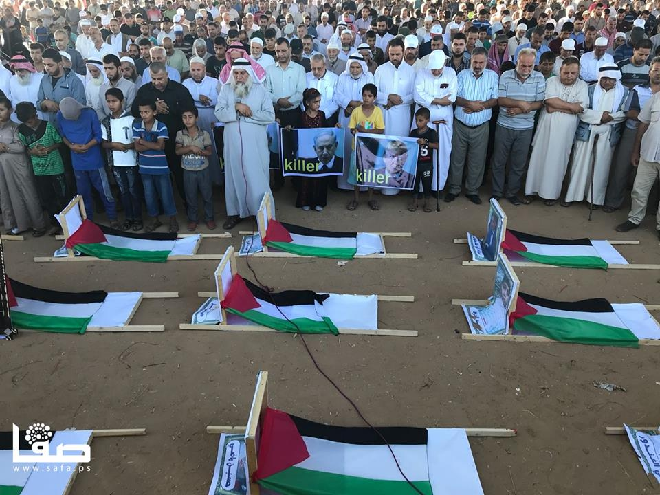 "Display at the mock ""cemetery"" of the children killed during ""return marches."" The children hold pictures of the the Israeli prime minister and the American president, both with the caption ""killer"" (Safa Facebook page, July 27, 2018)."