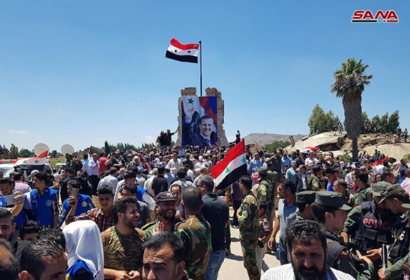 Syrian flag and a picture of Bashar Assad on Tahrir Square in Old Quneitra (SANA, July 27, 2018).