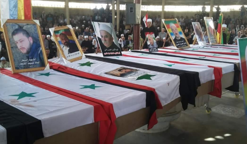 Coffins of some of the Druze who were killed in the ISIS attack (Enab Baladi, July 26, 2018).