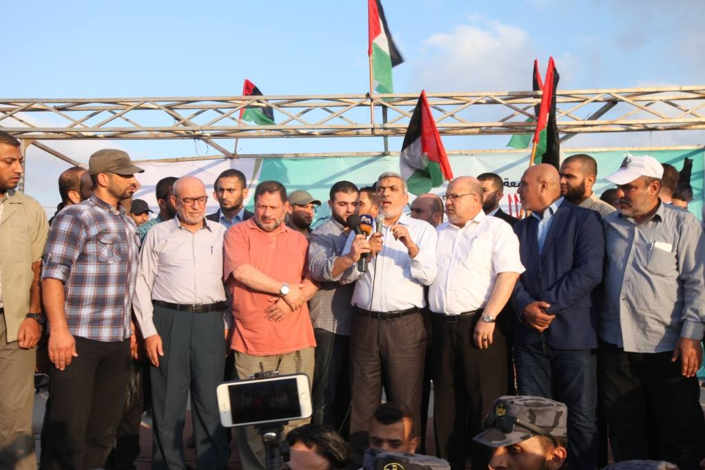 Members of Hamas' political bureau Izzat al-Rishq and Maher Abid (in the orange shirt in the picture at the left), who came with Hamas'