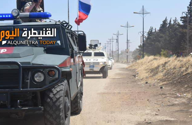 Bullet-proof vehicle of the Russian Military Police leading a convoy of UN vehicles near the Syrian-Israeli border.