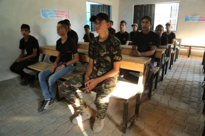 A theoretical lesson in the classroom and classes on operating weapons; documentation from the first day of the evening camp at the Yarmouk outpost in the Khan Yunis Province.