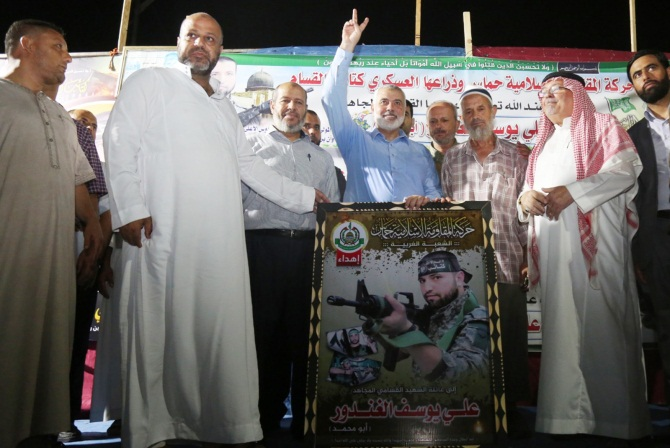 Isma'il Haniyeh (center) at the memorial service held for Ali Ghandour, killed in an IDF strike (Hamas movement website, August 12, 2018).