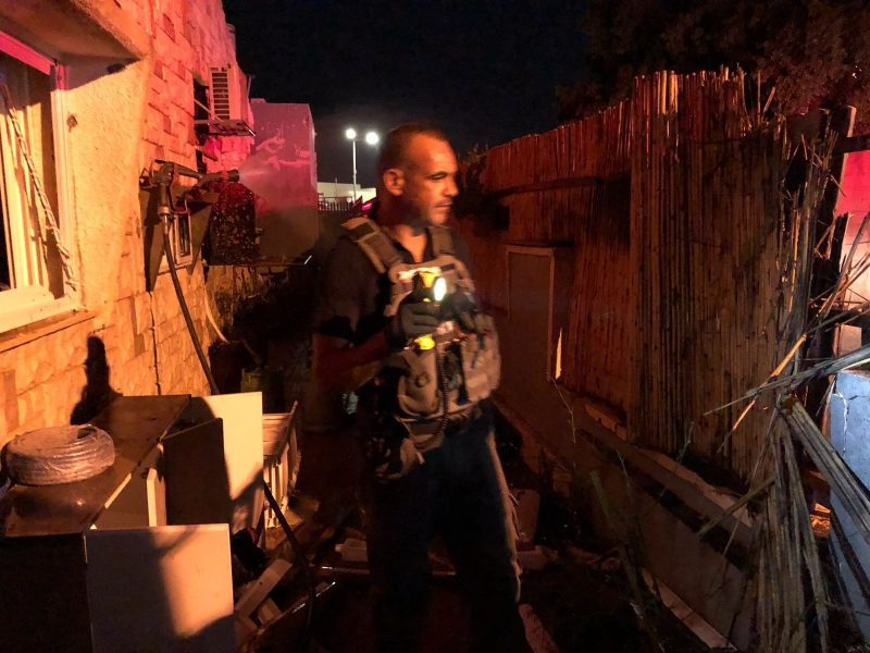The Israeli security forces deal with a rocket that landed in the southern Israeli city of Sderot (Israel Police Force spokesperson's unit, August 8, 2018).