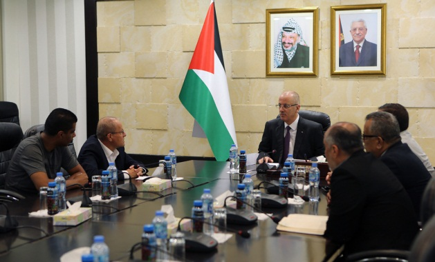 Rami Hamdallah meets with a delegation headed by Qadri Abu Bakr (Wafa, August 13, 2018; website of the Committee for Prisoners' Affairs, August 13, 2018).