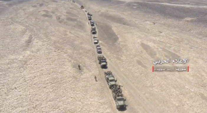 Syrian army column of forces moving in the As-Suwayda Desert (from a video of the Syrian Army's Information Office) (Twitter account of Hezbollah's Central Military Information Office, August 8, 2018)